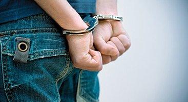 raleigh bail bonds men in cuffs